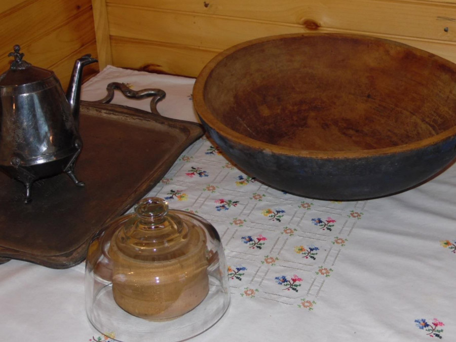 Carved butter press and wooden bowl